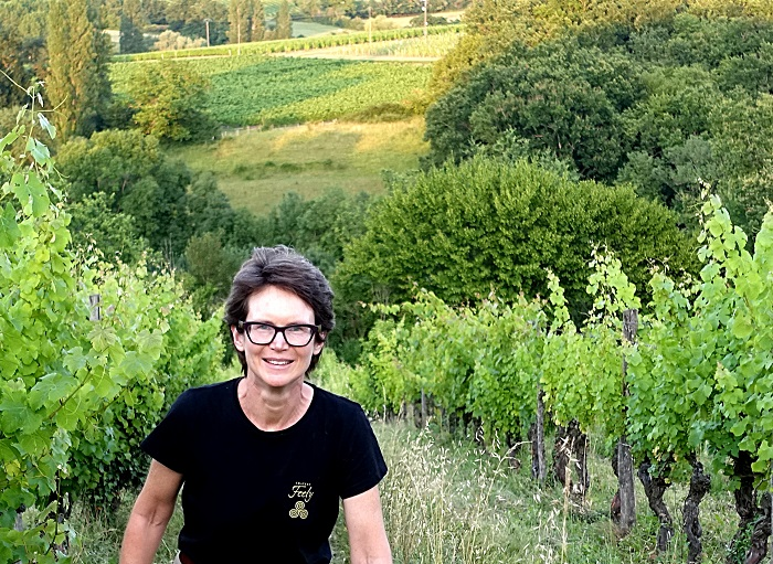 caroline feely walking in organic vineyard